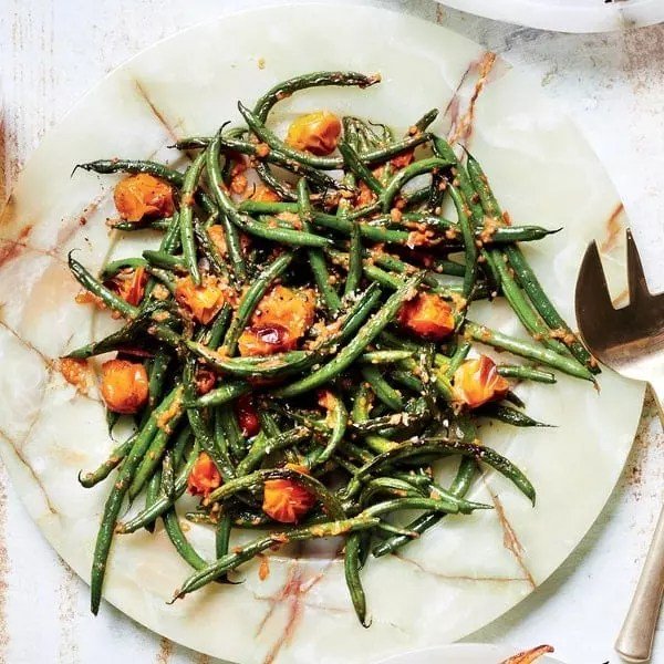 Vegetarian Romesco Roasted Potatoes and Green Beans plated on a marble platter