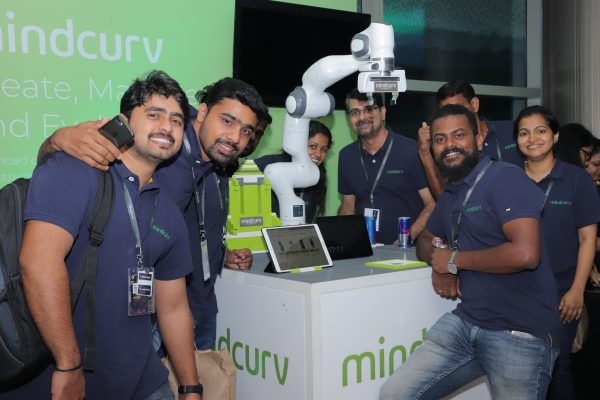 Mindcurv members gathered around Panda showcase during the AWS Cochin event