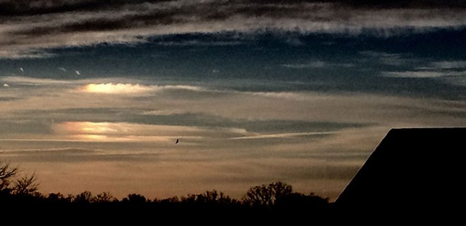 A sundog visibile in the icy clouds on a crisp January morning in Arkansas.