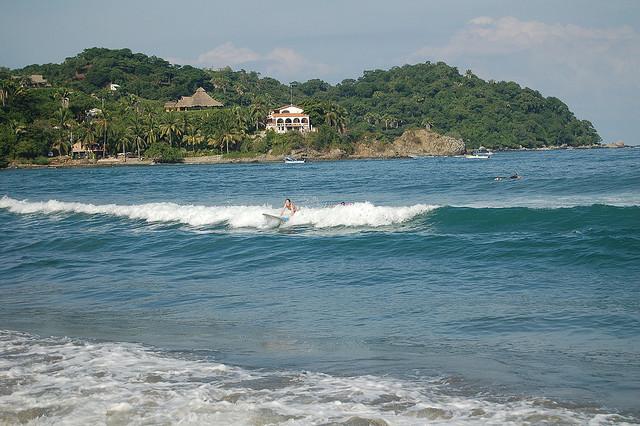 Sayulita, Mexico surfing by Pugawug via flickr cc