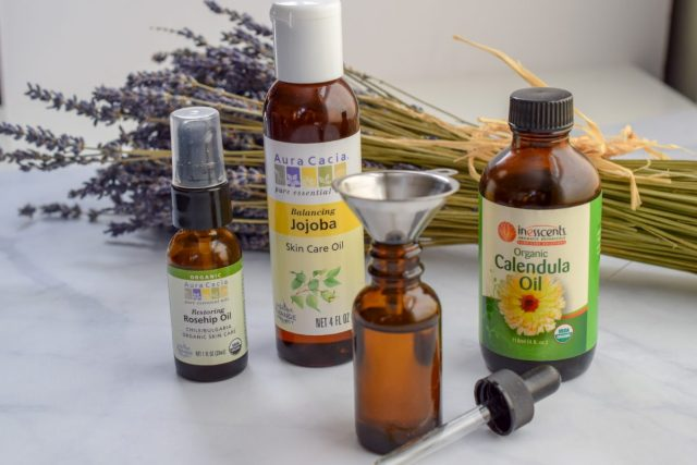 facial oil ingredients with stainless steel funnel