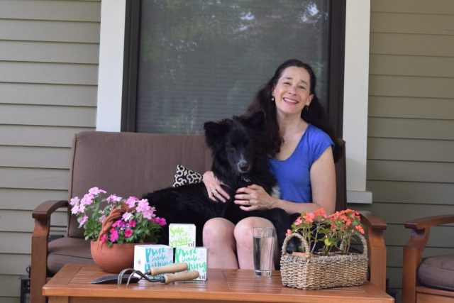 porch with dog, flowers and Oi feminine products