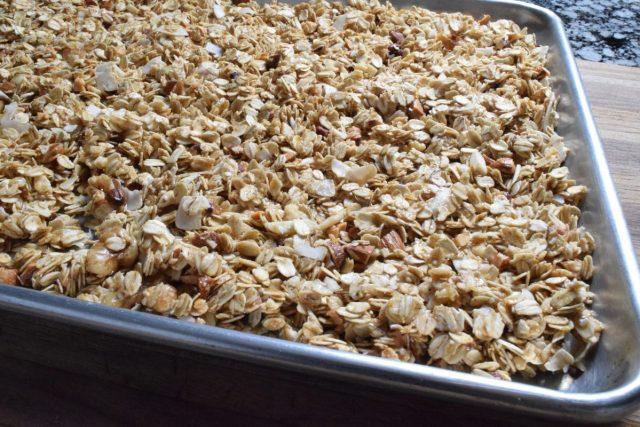 Homemade granola on rimmed baking sheet