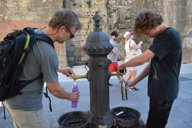 Filling up water bottles in Barcelona