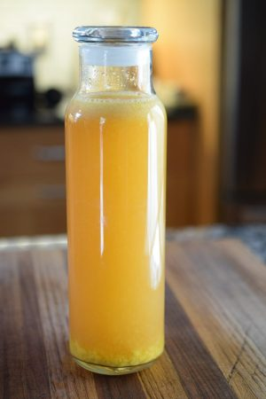 Mango Kombucha in bottle on counter