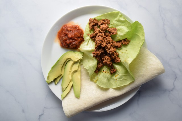 Taco meat and avocado on a plate