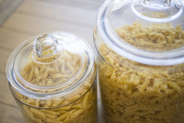 glass jar filled with dried pasta