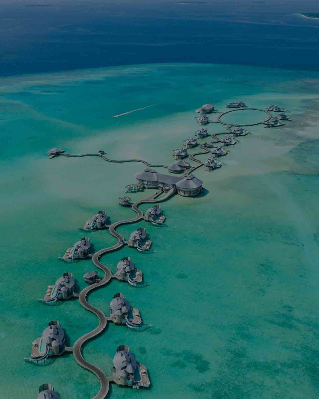 birds eye view of maldives luxury villas and turquoise waters