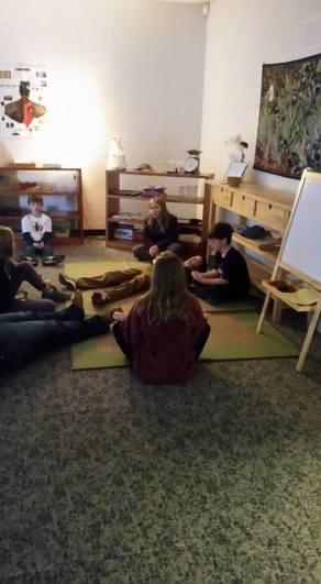 upper elementar students meditate