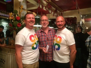 two members of the coop lgbt team with a member from mindout