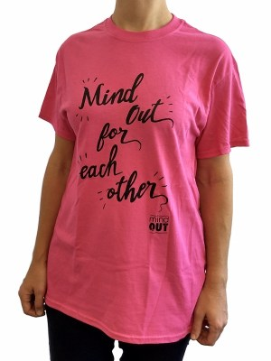 "figure wearing pink tshirt with black logo reading ""mindout for each other"""