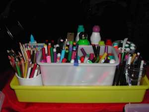 Use a cleaning caddy to hold art supplies