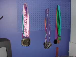Use a peg board to hang jewellery or medals