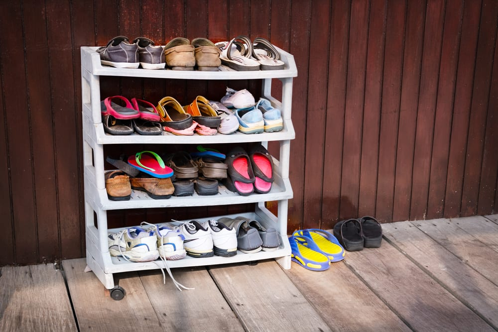 Use vertical space to prevent footwear form sprawling all over the entry way