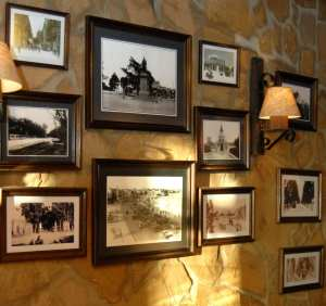 Pictures in frames hanging on an old wall