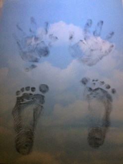 We made this sheet of his hand and footprints after he passed and took a small clipping of his hair.