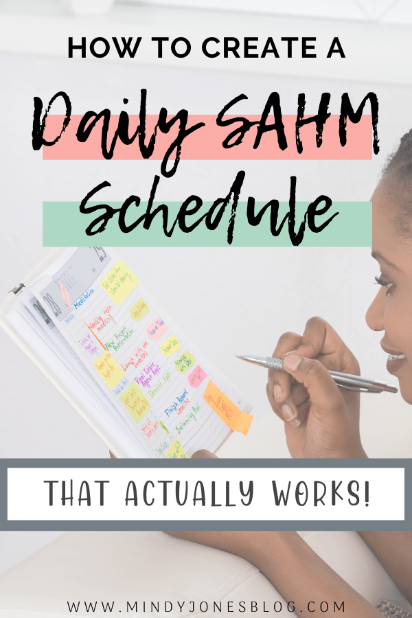 create a daily SAHM that works with woman holding planner