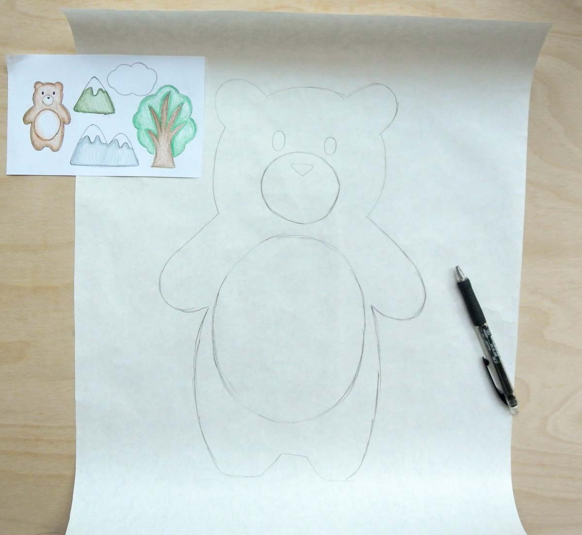 Shows original bear plush design and enlarged bear plush pattern sketch with mechanical pencil on right side. How to Make Plushie Tutorial