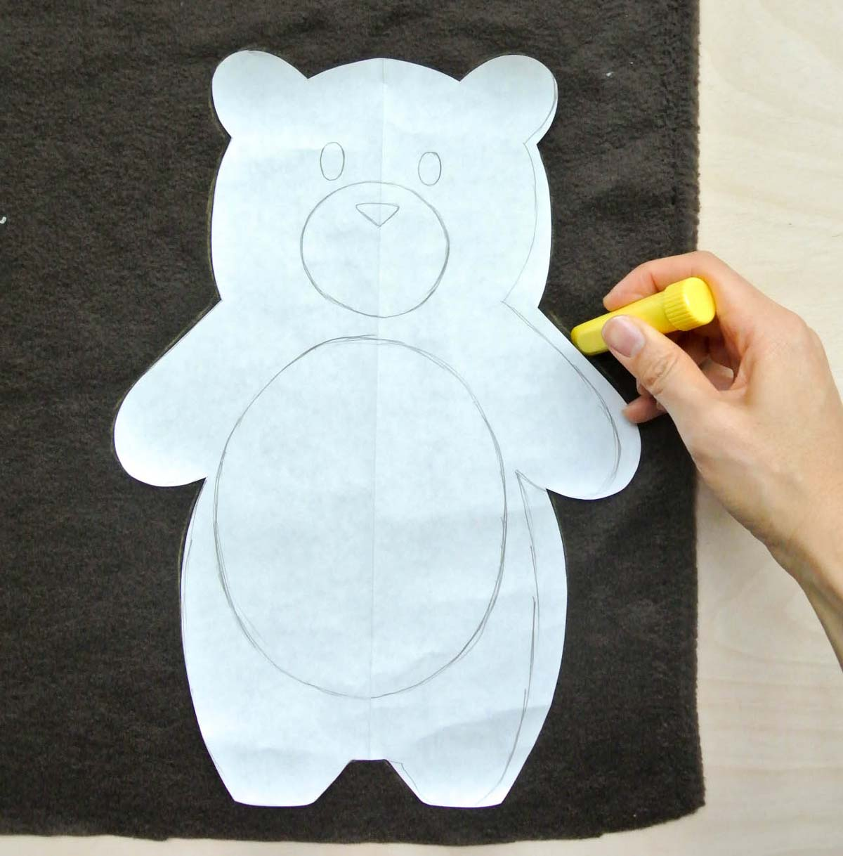 Bear Plush Tracing pattern with yellow quilter's chalk on brown fleece fabric. How to Make Plushie Tutorial