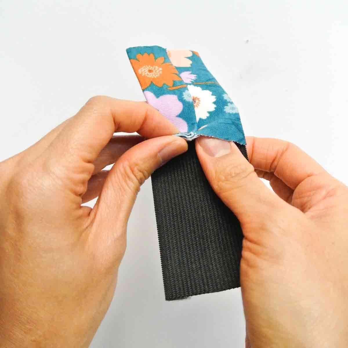 Inserting elastic into elastic piece of DIY headband