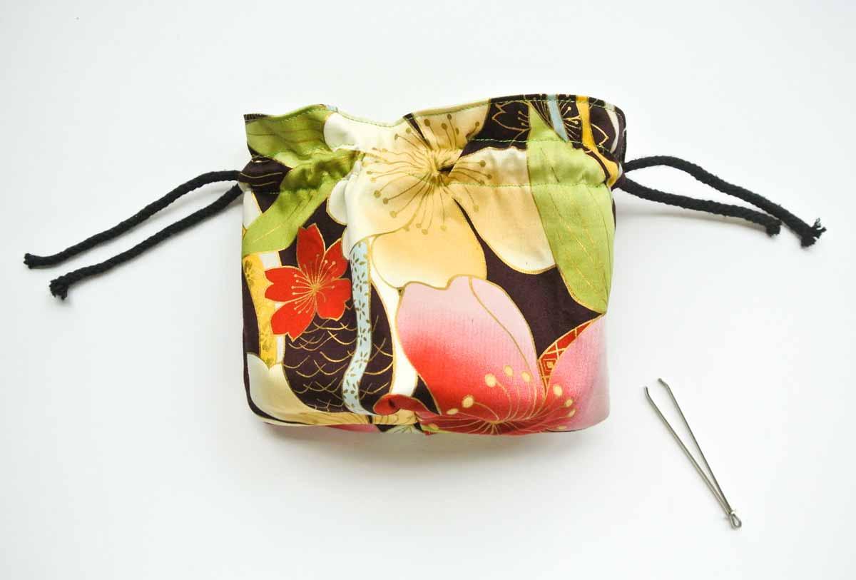 Pulling drawstring through dice bag. Dice bag pattern