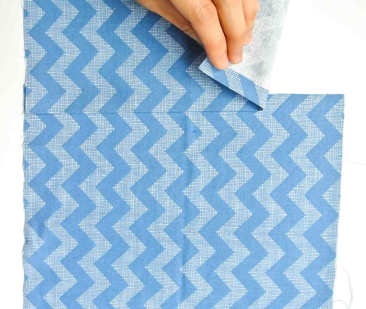 laying fabric together to match pattern prior to slip basting