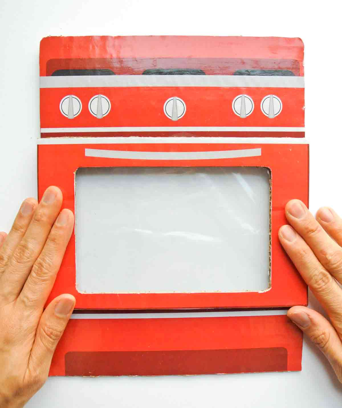Gluing Front oven door on top of cardboard oven. Toddler Cookie Counting Activity Free Printable
