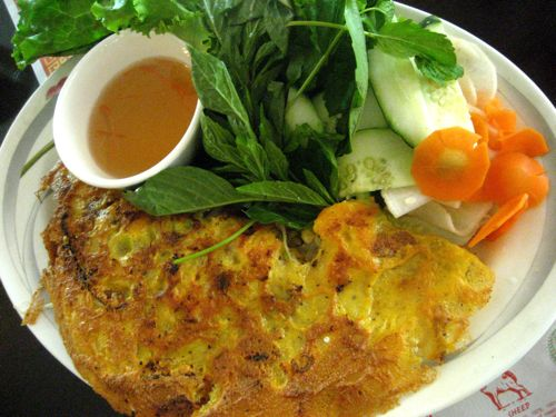 banh xeo - it's an eggy crepe filled with shrimp and pork that's served with pickled veggies and herbs to be wrapped in lettuce