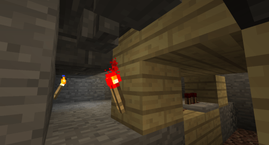 A hopper sits directly below the dispenser but it is disabled by a redstone torch. This is how the filled water bucket will leave the dispenser when the time is right.