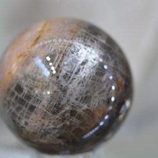 Pierre de lune noire sphère 330