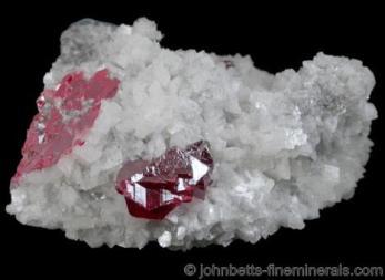 Cristales de cinabrio hernados en Dolomita