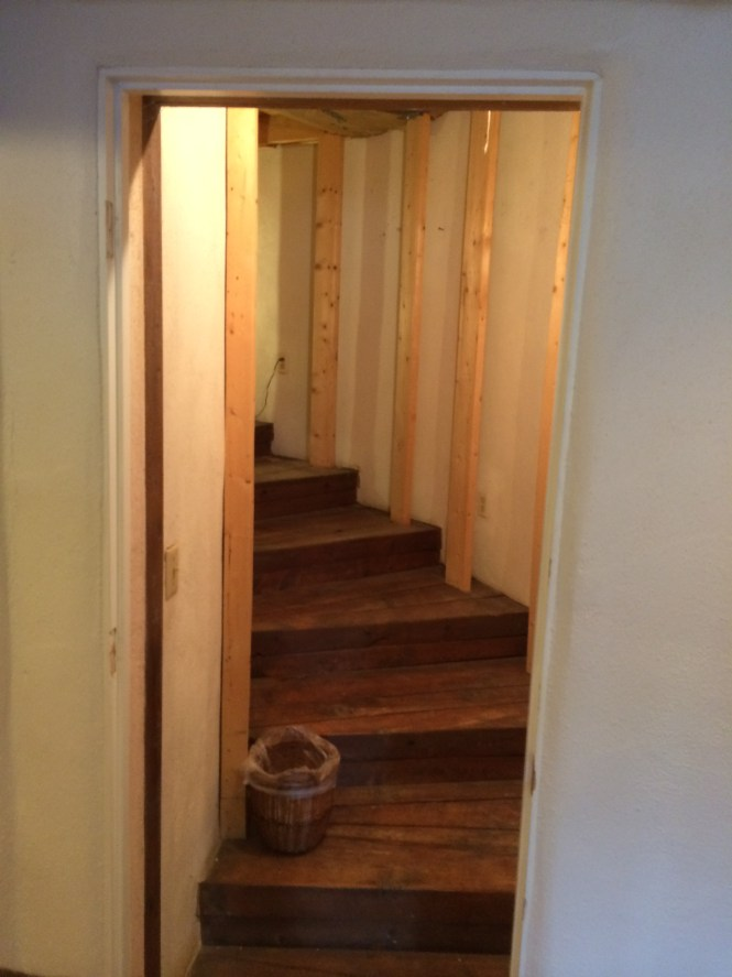 The hidden staircase beneath the floor