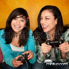 stock-photo-attractive-hispanic-woman-and-girl-playing-a-video-game-with-handheld-controllers-48455071
