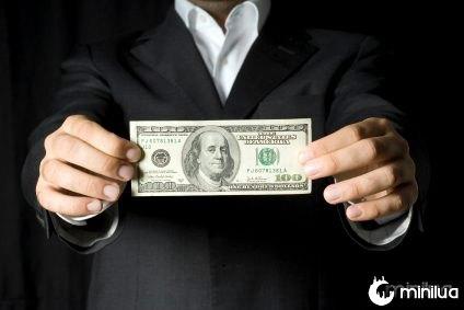 Man-holding-money-large