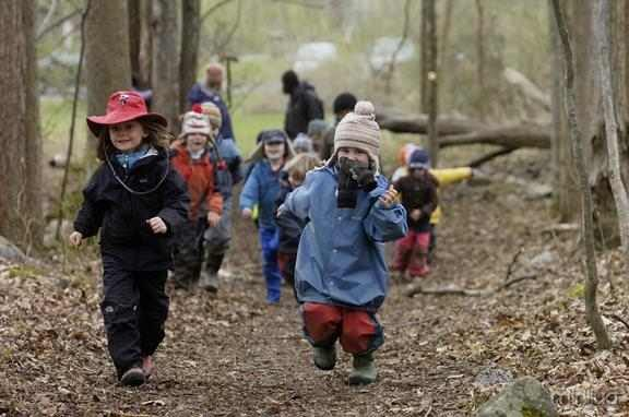 Waldorf School of Saratoga Springs Forest Kindergarten students bundled up in hats, coats, waterproof pants and boots enjoy the outdoors last week. Forest Kindergartners spend the entire school day in the woods, learning while they connect with nature. (ERICA MILLER/emiller@saratogian.com)