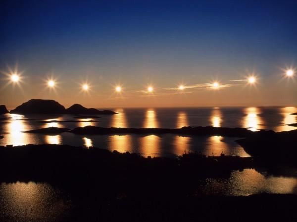 Night with a midnight sun Norlcapp Margeroi island Norway Sky Sun Sea