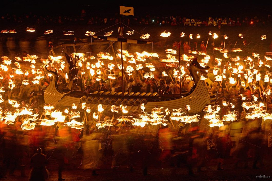 helly-aa-long-boat-torches-blur