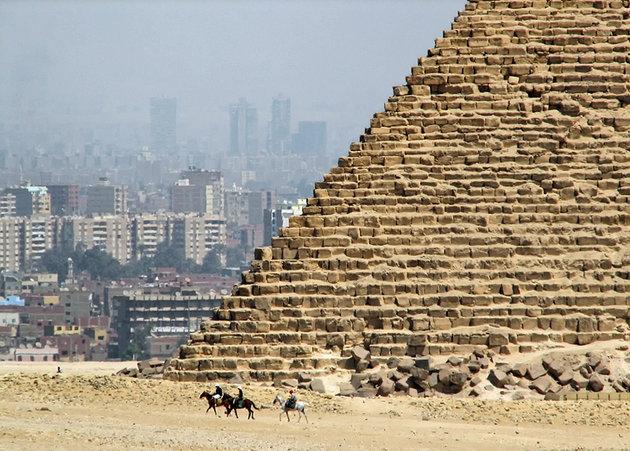 egypt-pyramids-of-giza-great-pyramid-stonework-with-city-behind