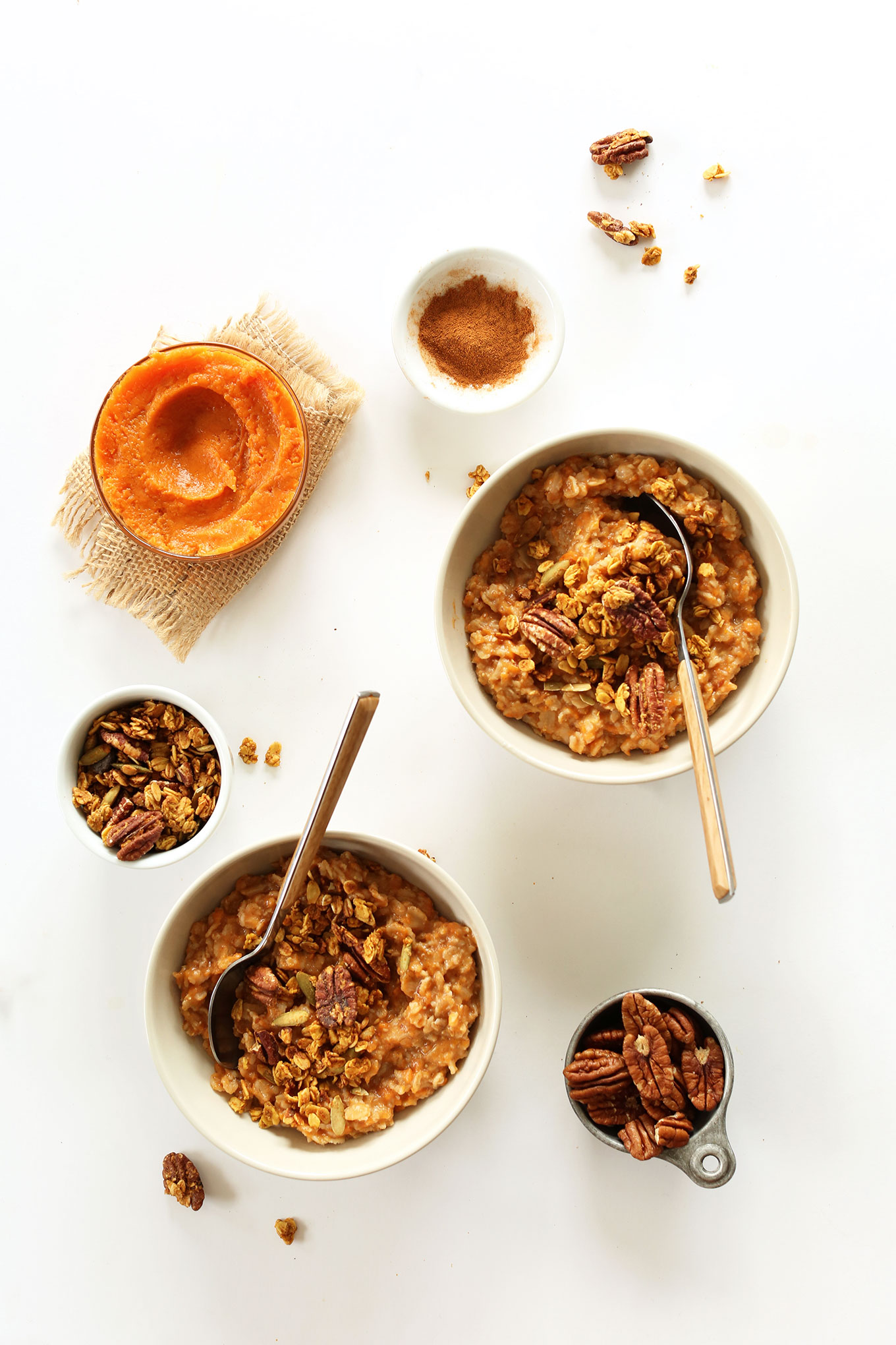 Bowls of our Sweet Potato pie Oats alongside nuts, puree, and cinnamon to make it
