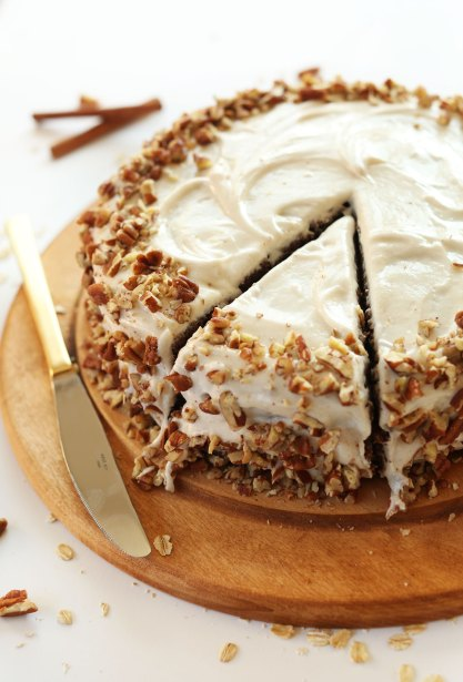 Cut slice of Apple Gingerbread Cake with Vegan Cream Cheese Frosting