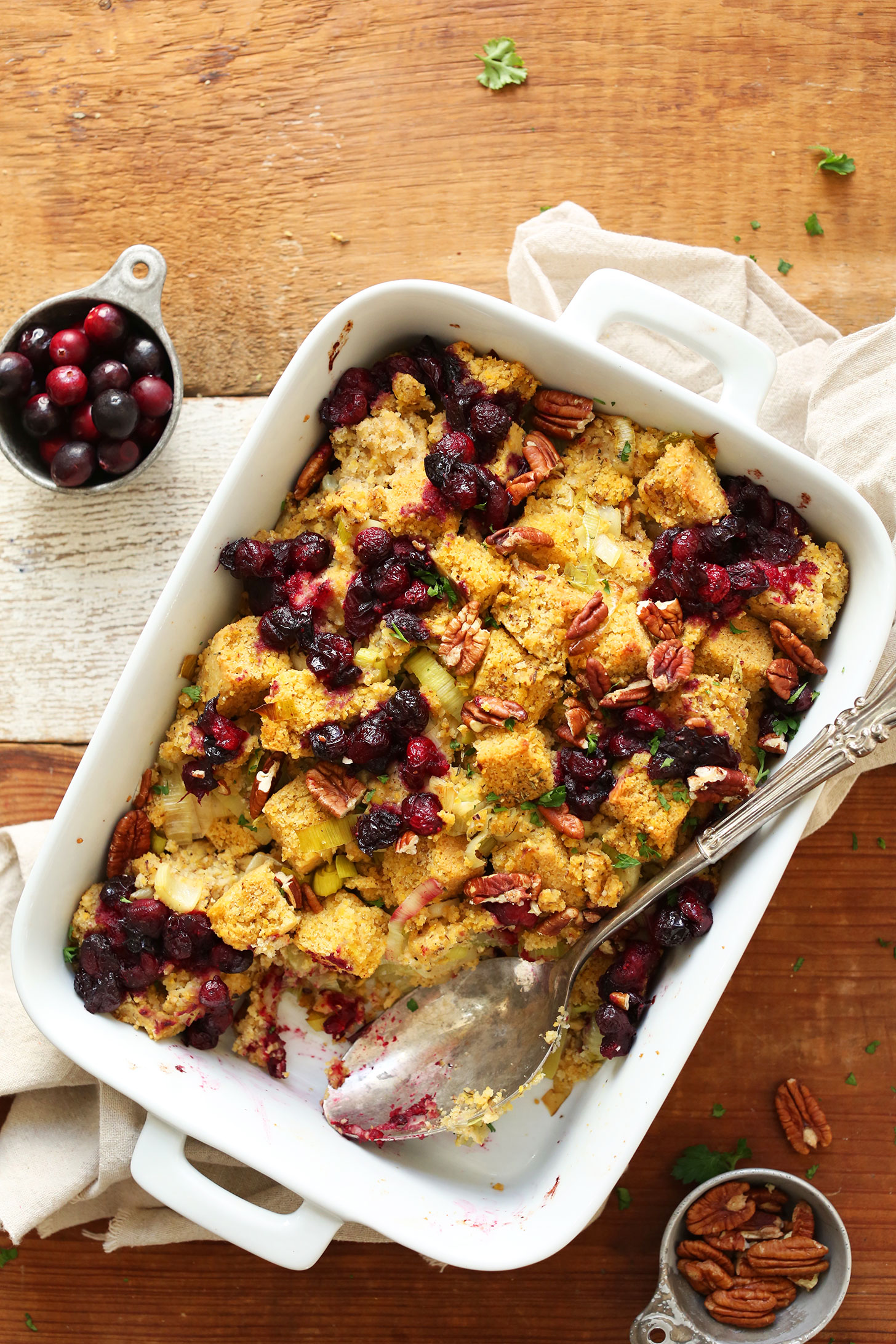 Vegan Cornbread Stuffing   Minimalist Baker Recipes Baking dish filled with stuffing for a gluten free vegan thanksgiving
