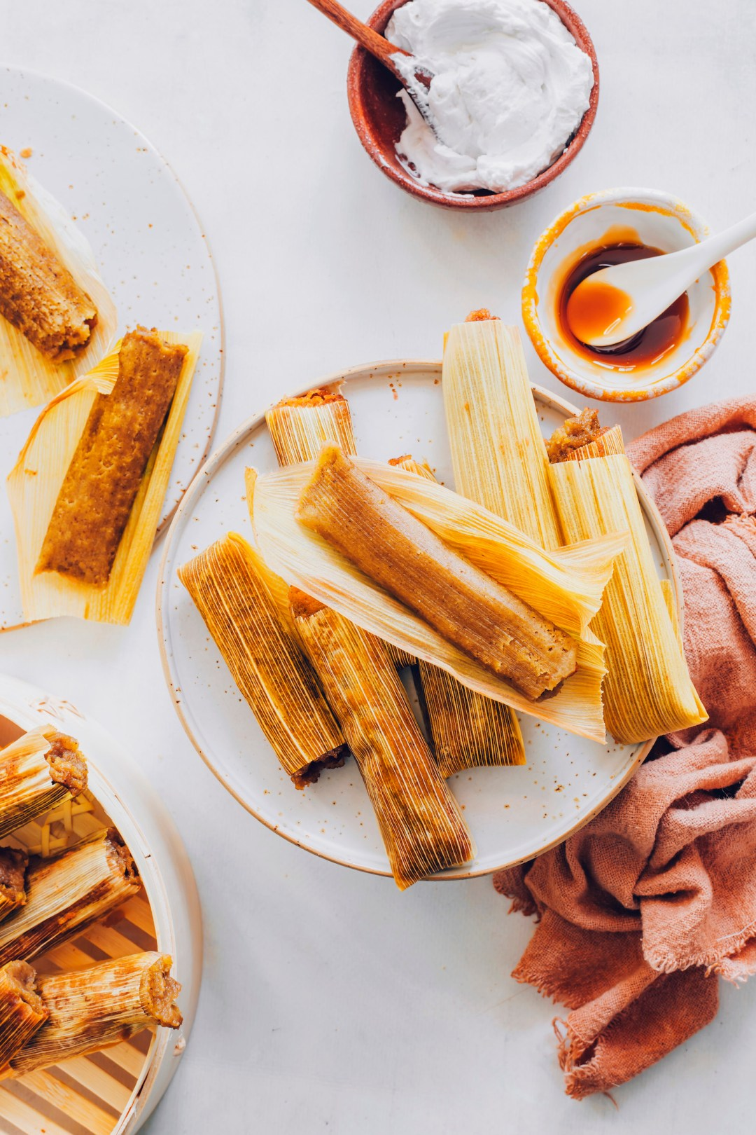 Plates of apple butter tamales in corn husks