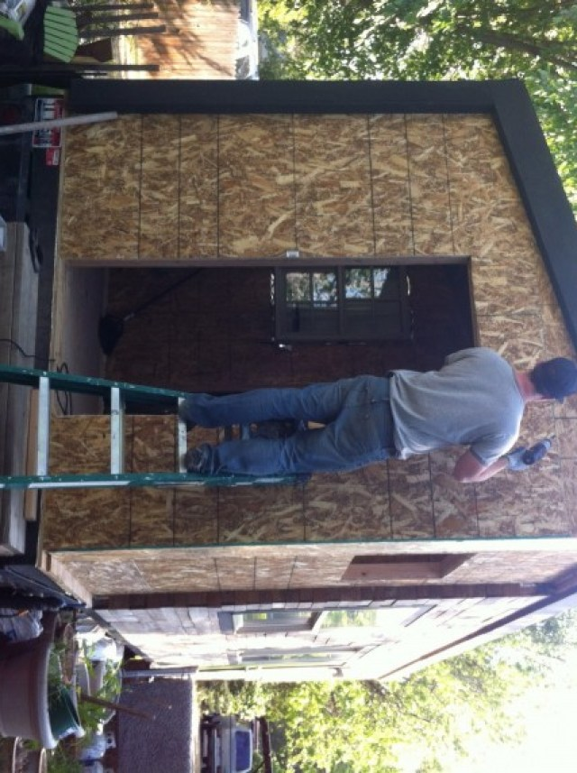 James finishing up screwing the sheathing in, it's probably good I'm not allowed on a ladder...