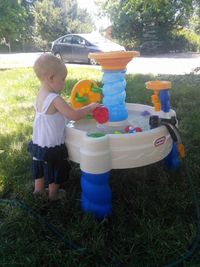 I believe this is the very first toy I have purchased for Hazel,  I hear it is the holy grail of toddler toys and I think it is.   It has gotten up to 111 already this year, this water table has been AWESOME to occupy her outside while keeping things cool, and we have a nice shady yard to play in it.