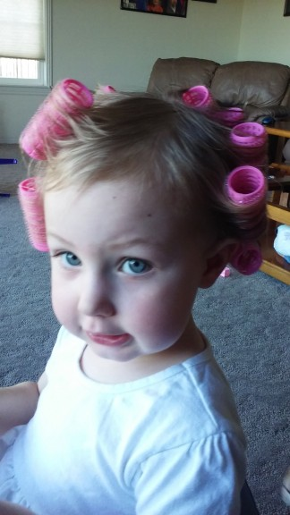 She LOVED getting her hair done... I'm not sure where she gets this from, I HATED it.