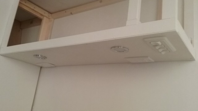 The lights and AC outlets got installed under the  upper cabinets