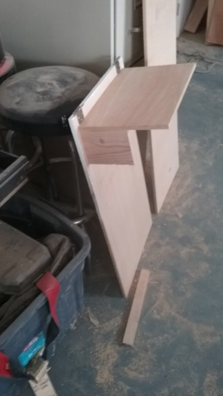 The cabinet faces were cut and painted, this is the trash lean out 'thing'
