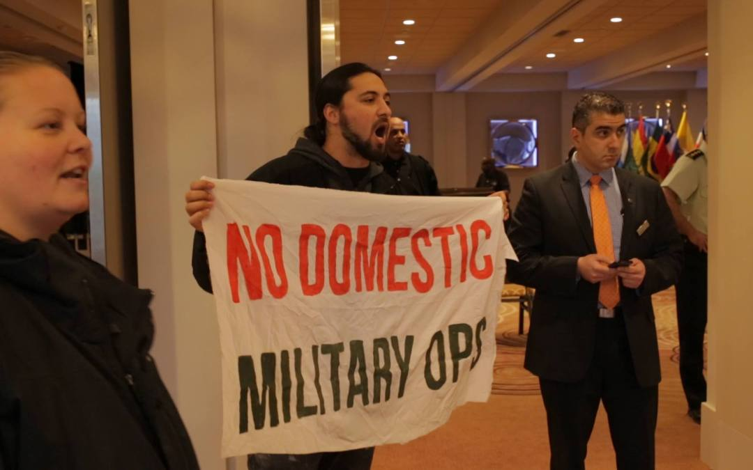 Activists disrupt international military conference in downtown Toronto hotel