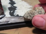 When the putty was a little bit hard, I used my favorite rock to imprint irregular patterns (useful to hide the inevitable fingerprints also...)