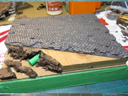 "I removed some individual stones from the road to damage it. Then pieces of cork were glued on the ""crater"" part of the diorama."